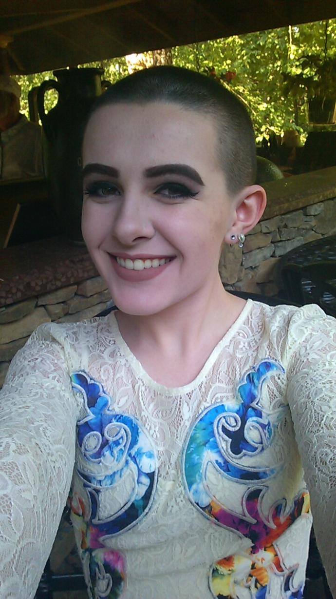 Guys: Would you date a girl with a shaved head?