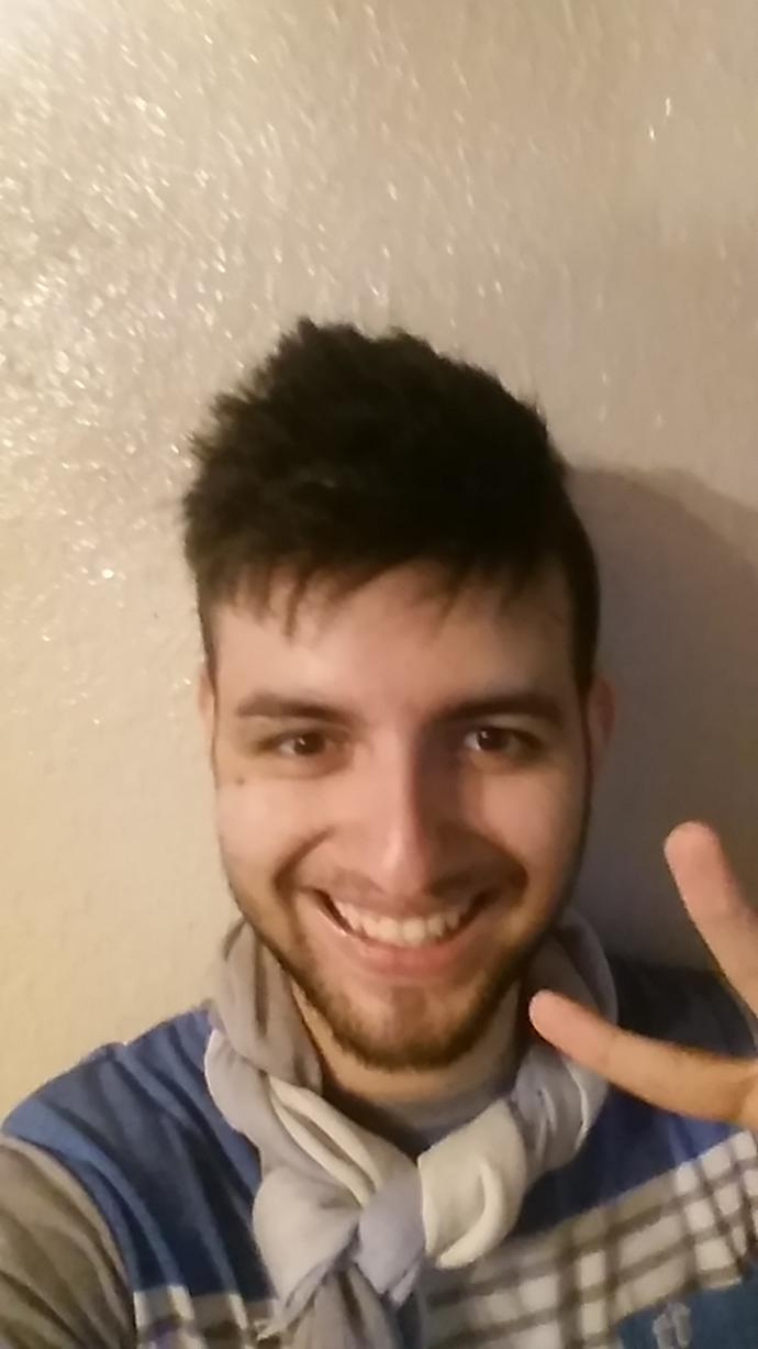 what haircut would fit me better, I want to try something new... I dont mind letting my hair grow?