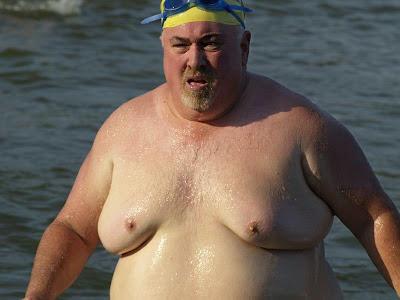 Why do girls like fat guys so much? Do you like man boobs?