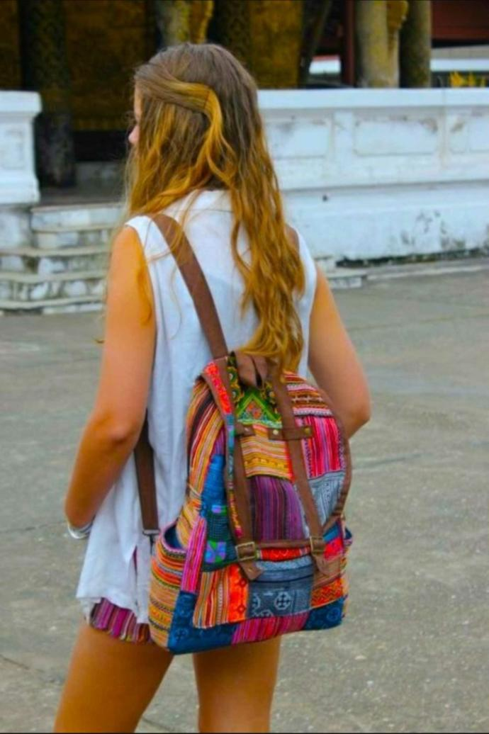 why do girls wear their backpacks with the straps all the way out??