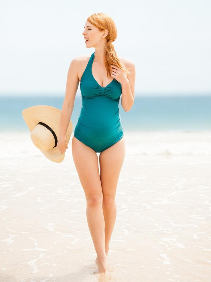 Would you say this model is actually pregnant? In one shot she's thin, then she looks pregnant?