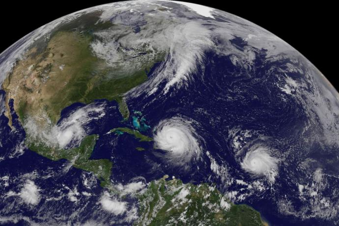 Does the occurrence of three major hurricanes this year prove that global warming is a real phenomenon?
