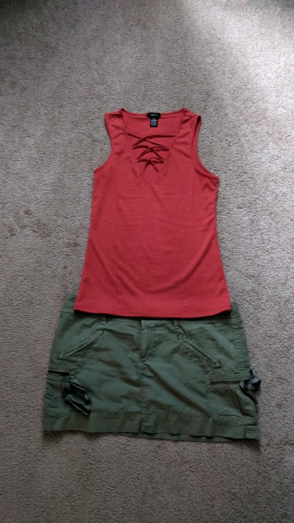 What color top with a grey green skirt?
