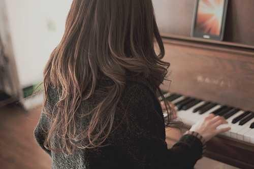 A girl playing guitar or piano??