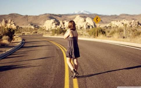 Is it safe or wise for a woman to hitchhike alone?