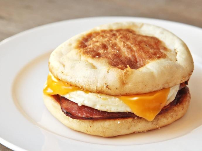 How often do you buy breakfast sandwiches? If so, do you prefer bacon or sausage with the egg and English muffin?