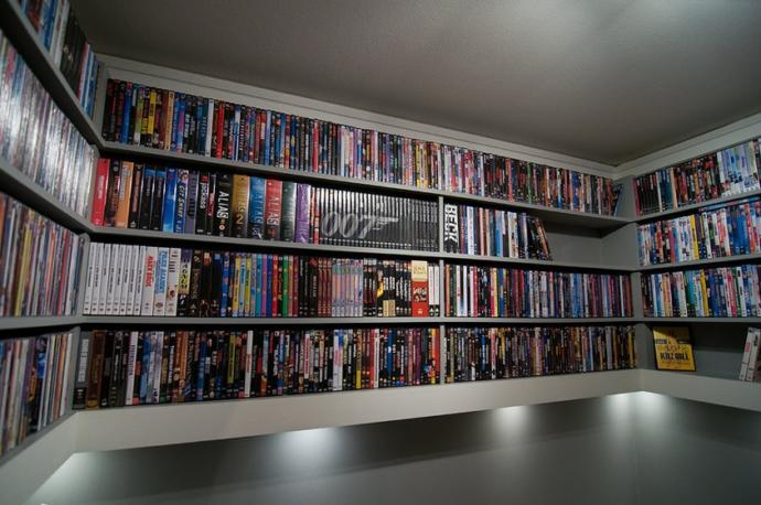 Which hobby do you prefer doing at home, buying a large collection of movies on DVD/Blu-Ray to watch or play a large library of video games?