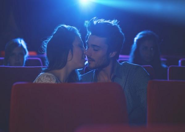 Is it weird to kiss at the movie theater?