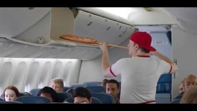 Is this man making pizza the right way?