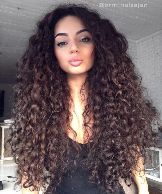 Guys, is straight hair or curly hair more attractive on a woman?