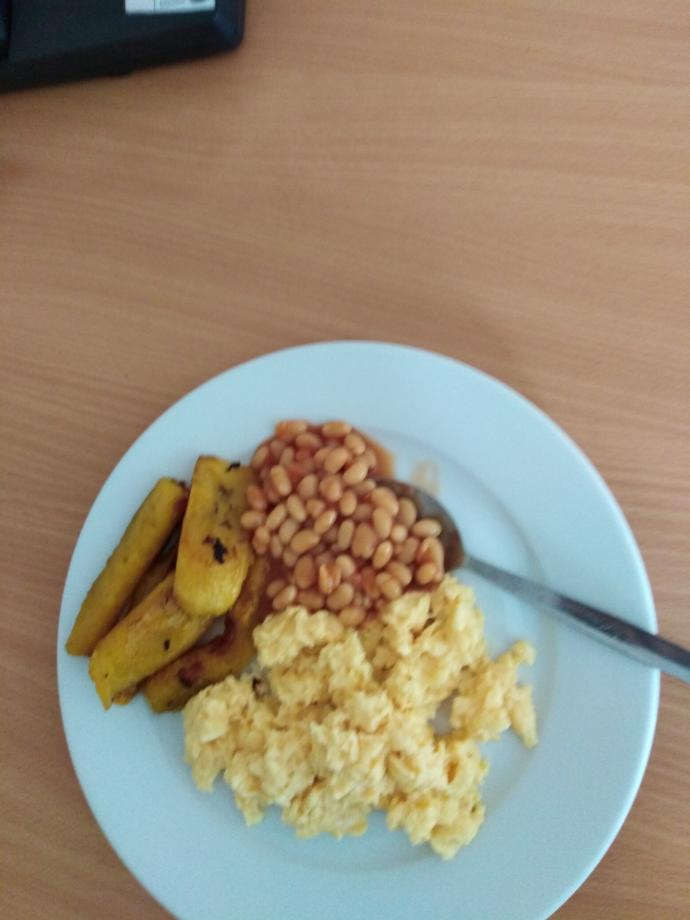 Is this the best breakfast ever. Beans, scrambled eggs, plantain, croissants, strawberries, grapes, yogurt and orange juice?