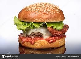 Hey GAGers, do you think vegetables (lettuce, tomatoes, onions, etc.) taste well on burgers or does it detract the flavor?