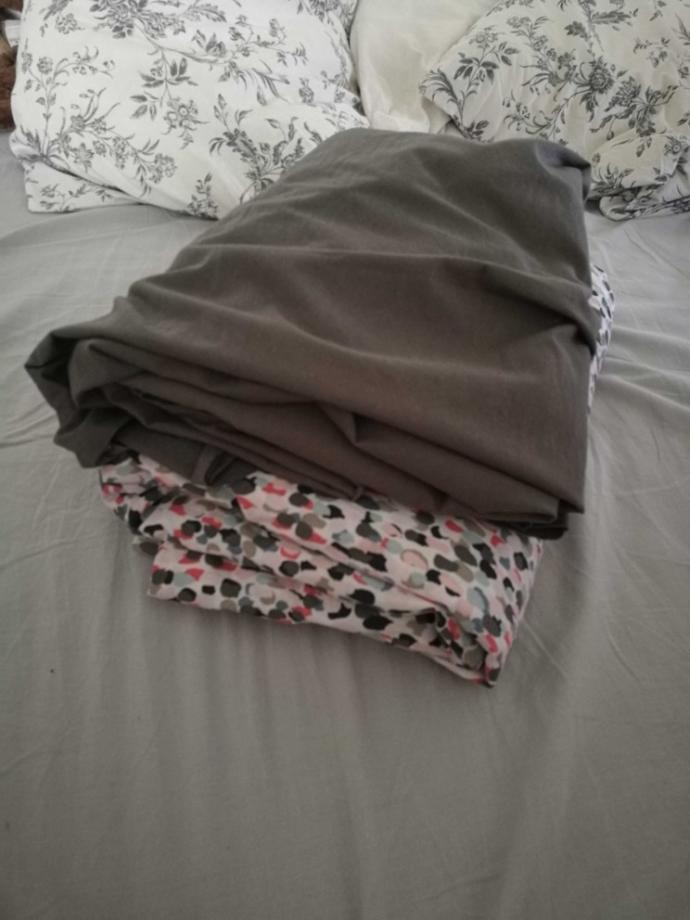 How do you fold sheets nicely by yourself?