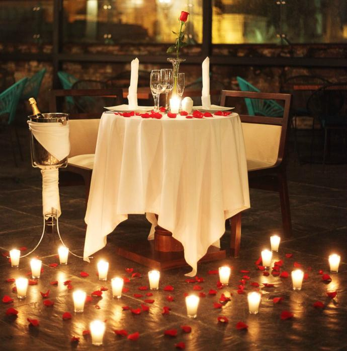 Which romantic gesture would you prefer - a surprise candlelit dinner, or your SO surprising you with breakfast in bed?