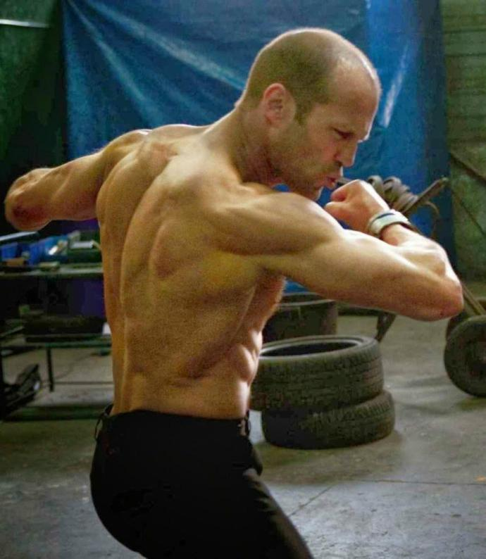 Is it possible to lift as much as a powerlifter and still keep a Jason Statham physique?