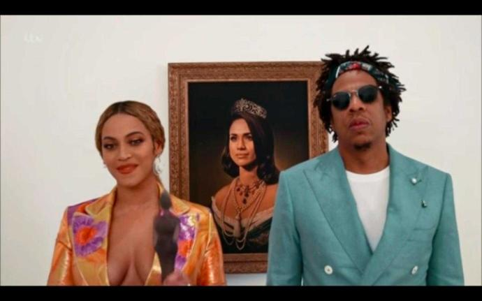 Jay z and Beyoncé accept Brit award in front of Meghan Markle portrait. Thoughts?
