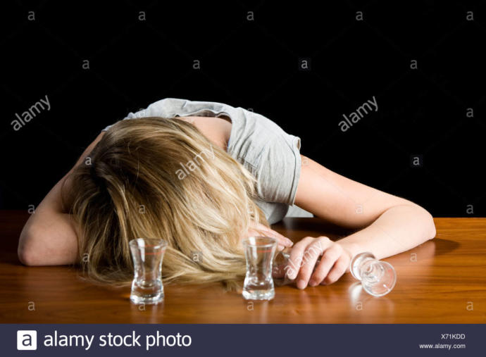 A woman's passed out drunk in front of your place. What do you do?