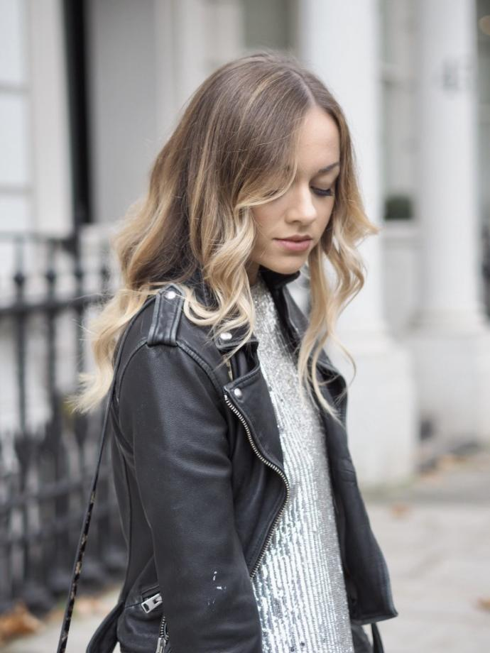 What do you think of her style? Do you think she is feminine or edgy or both? Does her jacket go with the rest of her outfit?