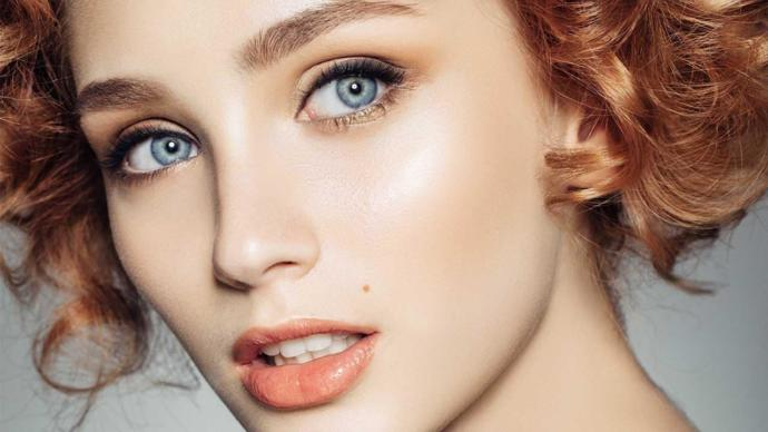 Why are blue eyes considered attractive?