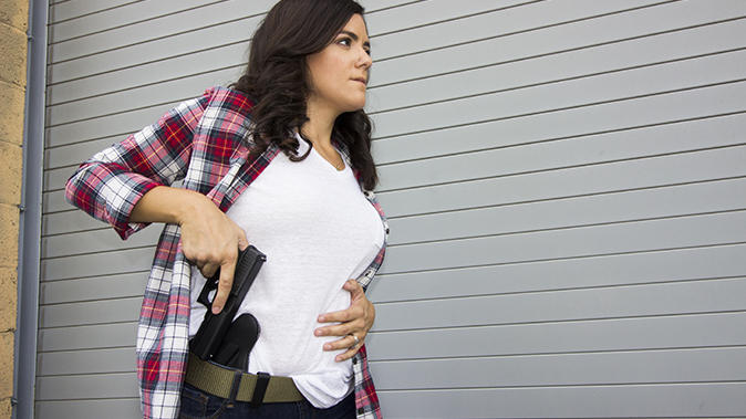 Guys, would you date a girl who, legally, carries a gun?