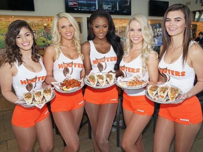 Why do some women agree to go to establishments like Hooters with their men just to sit there angry?