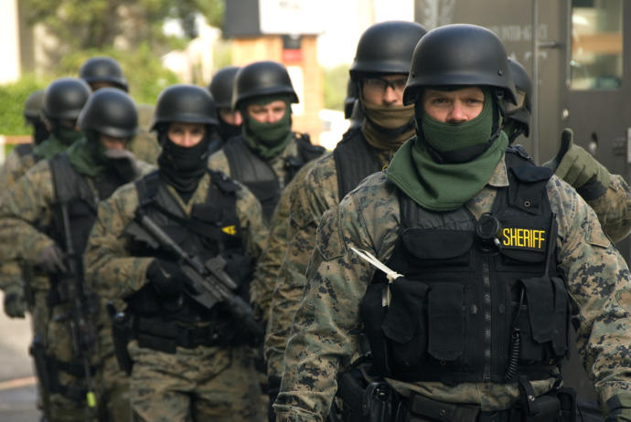 Well trained and armed civilians... like these sheriffs and SWAT