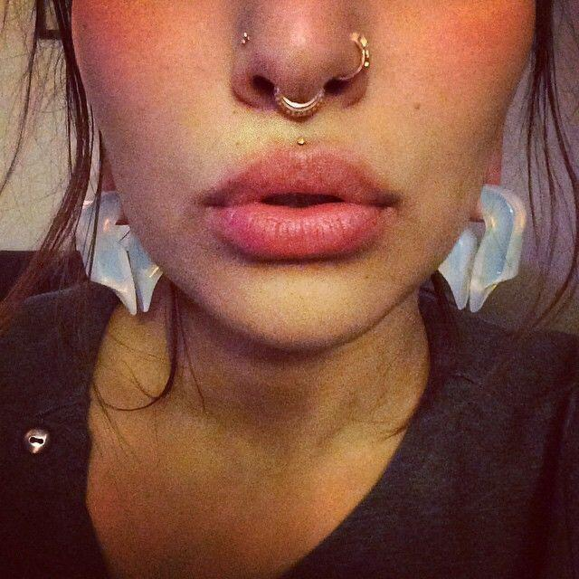What type of pain should I expect for septum and nose piercing?