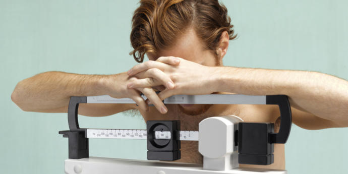 Why are eating disorders in men commonly overlooked?