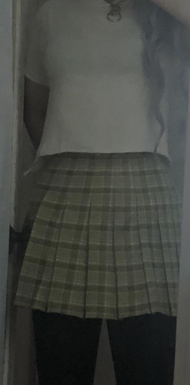 Which green plaid skirt should I keep (Don't worry about the t shirt. It's just an under shirt)?