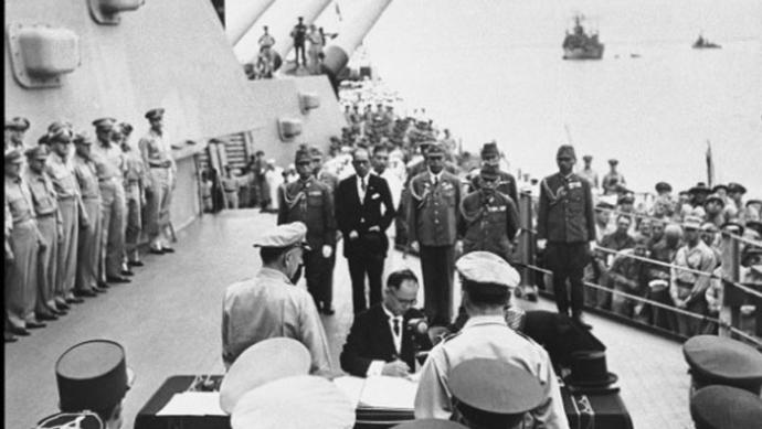 September 2, 1945 Japan surrenders on the deck of the USS Missouri in Tokyo Bay.