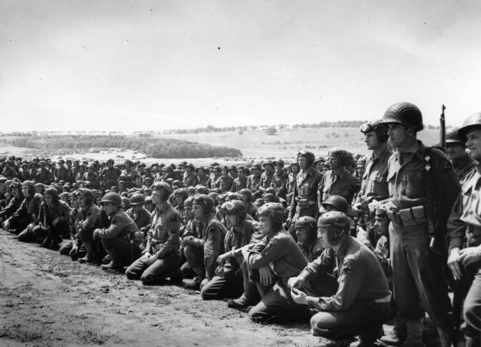 American armored unit being lined up for a briefing from their commanding officer prior to receiving their D-Day assignments.