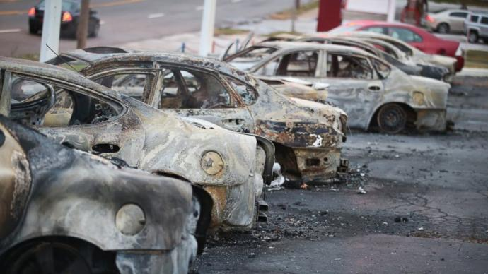 Cars which were set on fire when rioting erupted following the grand jury announcement in the Michael Brown case
