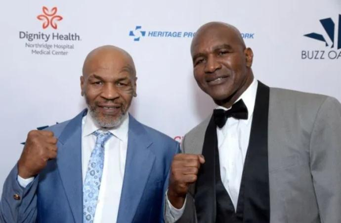 Who wins in the comeback fight Mike Tyson or Evander Holyfield?