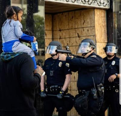 Should Social Services take this child into care after her father took her to a BLM riot?