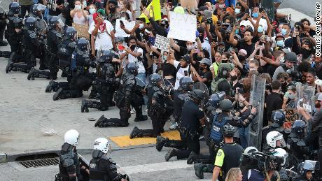 protesters approached the police officers knelt and confessed they needed to do better. People began crying and praying.