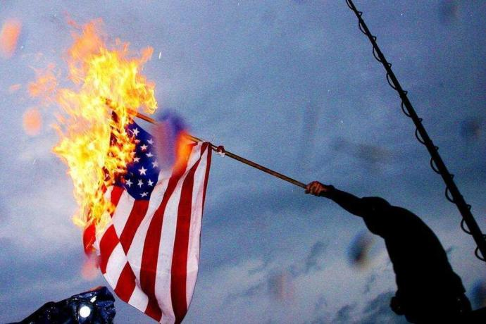 Is burning the U. S. flag on July 4th considered disrespectful or a celebration of the liberty it represents?