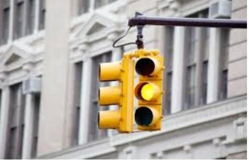 What do YOU do at the light as its turning yellow: go through, slow down, or stop?
