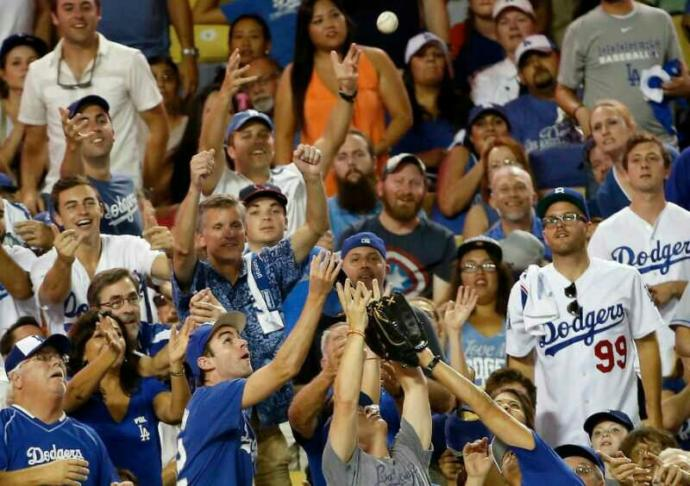 At a MLB game, is it rude to ask a fan who catches a foul or home run ball if you can have the ball?