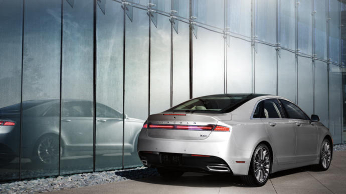 Lincoln MKZ. Id take a Continental too. Very classy cars.