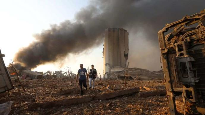 A huge cache of ammonium nitrate, an explosive compound, had been stored at the blast site.
