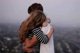 What should be the proper reaction for a guy when a girl who is not his girlfriend is crying in his arms?