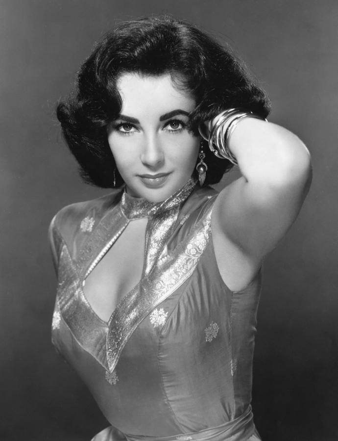 Of the Classic/Iconic Beauties (Elizabeth Taylor, Marilyn Monroe, Audrey Hepburn, Judy Garland) who would you say was the most striking / attractive?
