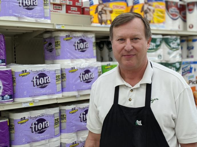 Why do grocery/super market staffs wear apron?