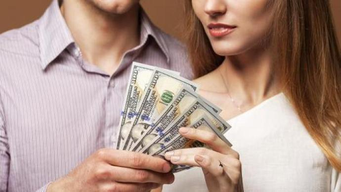How do women feel when their boyfriend/husband gives her his money?