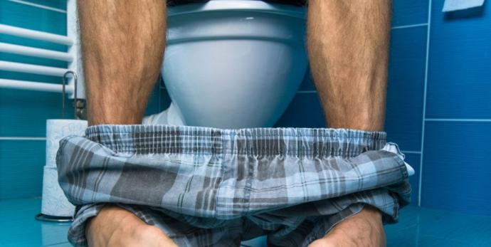 Is it okay for a guy to pee sitting down?
