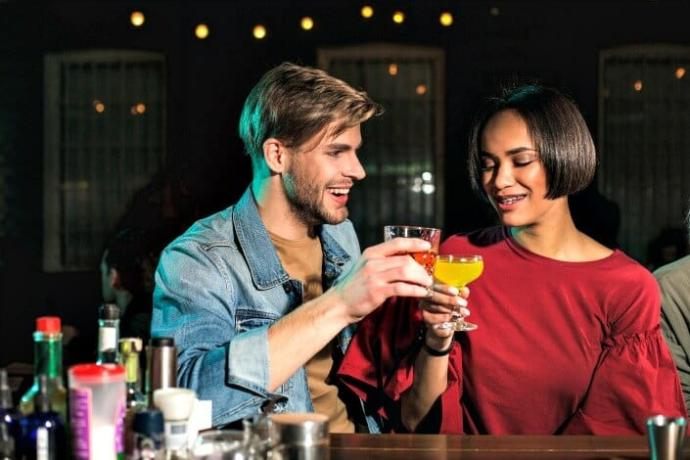 Why do men believe they'll find love at a bar?