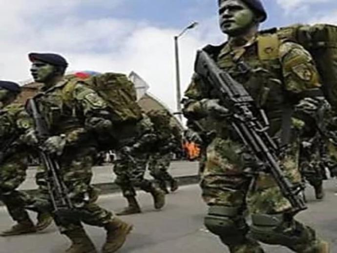 What is the purpose of men in the Army wearing green face paint?