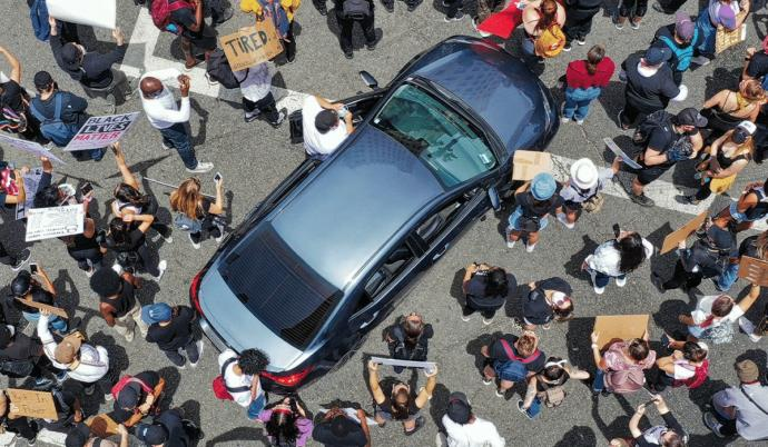 If a bunch of people surround your car, should you be allowed to do the following?