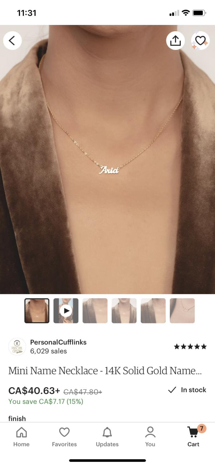 Do you think it's corny to wear a necklace with your name on it?