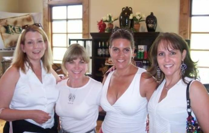 Four ladies who have all done threesomes with each other.